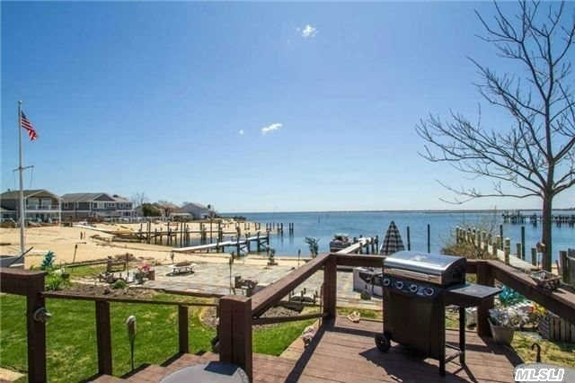 Prime Massapequa Shores Bay Front. Your Own Magical Oasis W/ Panoramic Bay Views. Protected Cove With Your Own Private Sandy Beach. 40'+ Pier. Extended Great Room With 9 Ft Slider To A Deck Over Looking Paradise. Downstairs All Brand New Tremendous Family Room- Beautiful Ceramic Floors, New Bath, New Heat System, Finished Part Basement.