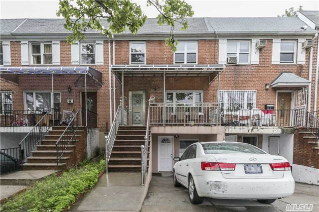2 Family Brick Attached In Flushing In Mint Condition, All Custom Made Kitchen Cabinets, Closets, Modern Light Fixutes, 3 Zone Heating,  New Radiators, New Gas Heater, 2 Large Balconies, Front Porch, A Must See! Recently Gut-Renovated. Great Investment Opportunity Or Ideal For Large Family.