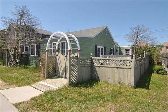 This charming home is all updated. 4 bedrooms and 1.5 baths.  Open living and dining area. Sunny rear deck with outdoor shower and hot tub.  Quiet and convenient Ocean Beach location. Central air conditioning.  Great summer home or rental investment.  Seller financing available.