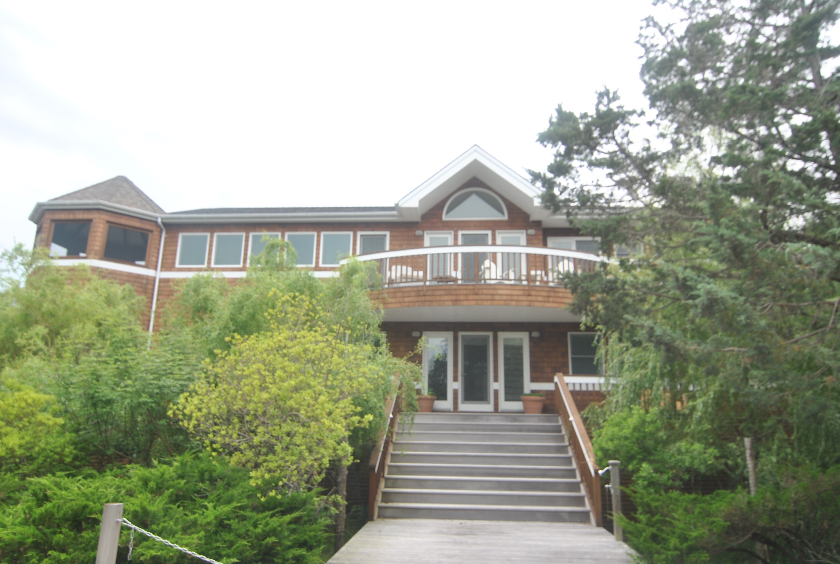 This custom built 3,224 square foot home is truly special.  Situated just 300 feet from the beach, it is the perfect vacation home for your large family.  With 5 spacious bedrooms, 3.5 bathrooms, huge open great room, expansive decks, and 2 screened in porches, this home has it all.  Large open kitchen with gas cooking and Subzero refrigerator.  Custom built-ins in every room. Massive 100' X 100' lot.  This home is a must see.
