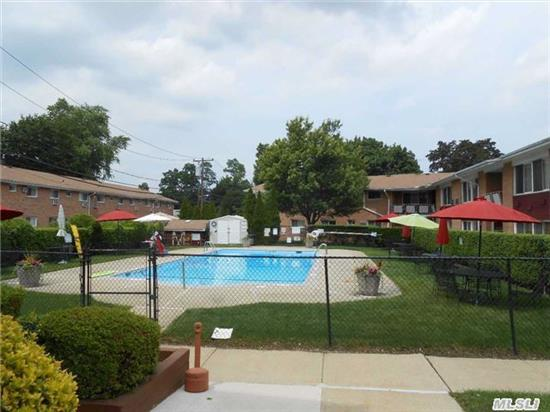 Pretty As A Picture! Best Location And Price In Suburbia On The Much Sought After 1st Floor Corner Unit With View Of Pool. Kitchen And Bath Updated Last 5 Years. Nothing To Do But Hang Your Clothes In This Pristine Unit. Laundryrm, Bikerm, Storage Bbq Area. High Walk Score To Farmingdale Village, Restaurants, Pubs And Lirr. Tax Inc In Maint Incl Heat $695.49 With Star