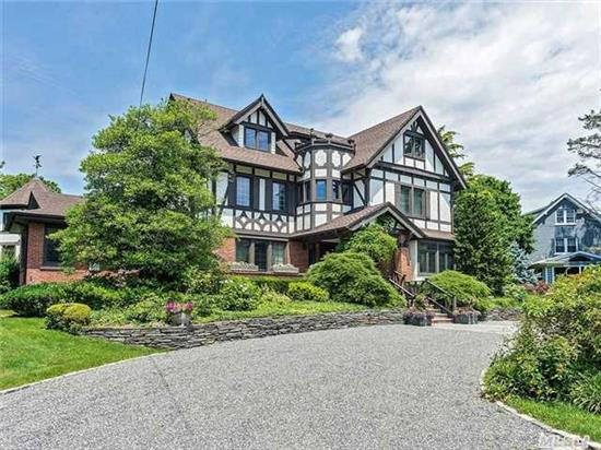 Grand Country Tudor Estate. 7 Bedrooms Up. Huge Entry Foyer, Eik And Tremendous Living Space On The First Floor. Library. Beautiful Property With Decking, In Ground Pool. Full Basement With 1 Bedroom, Full Bath, Complete Kitchen And Storage. Perfect Location.
