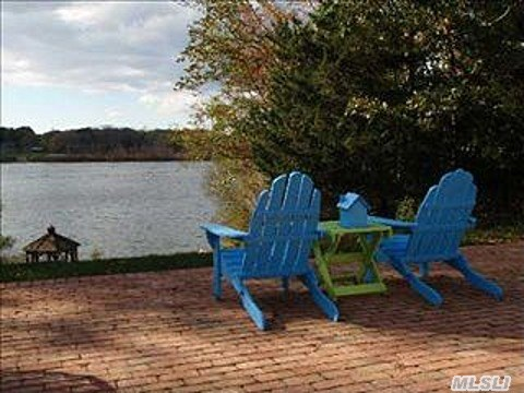 Waterfront Lakeside Setting With Panoramic Views And Sunsets. Large Living Room With Wood Burning Fireplace, Dining Area, Eat In Kitchen, 3 Bedrooms & 2.5 Baths. Full Basement, 2 Car Garage, Salt Water In-Ground Pool With New Liner, Hardwood Floors, Gazebo And Fishing Dock. A Must See!