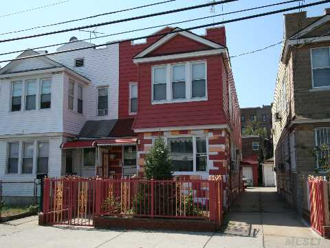 Two Family House Needs Tlc. Oversized Two Car Garage. Walk To #7 Train And All Your Shopping Needs.