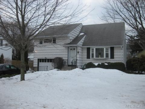 Wonderful Opportunity At An Affordable Price. The Perfect Location, Near Shopping, Schools, Lirr.  Large Backyard. Lovingly Cared For With Possiblities Galore. An Estate Sale Being Sold As Is.  This Home Is Just Waiting For Your Personal Touch...