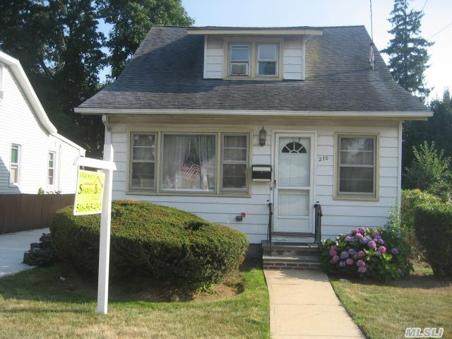 Cozy Colonial Close To Shops And Lirr. Hardwood Floors Beneath Carpets. Updated Kitchen. Large Lr And Fdr. Large 2 Car Detached Garage. 60 X 100 Property. Great Potential.