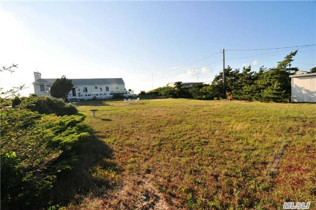 Beachfront Property On North Fork's Dune Road (Without The Problems!).Large Grassy Front Lawn And Rear Sandy Beach. Modest Home With Lots Of Potential - Enjoy It Now While You Make Your Plans For Your Special Beach Front Home,  Pool And More!