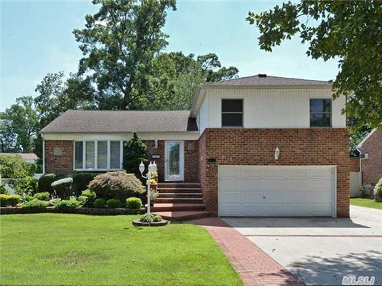 Renovated Brick Split-Level Located In The Desirable Terrace Section Set On A Quiet Cul-De-Sac. 4 Levels Of Exquisite Living Space Featuring A Large Eat-In-Kit W/ Granite Counters & Cherry Wood Cabs, Formal Dr, Lr W/ Vaulted Ceiling, Den W/ Pr, Fin Basement, 2-Car Garage & Sunroom With Access To Backyard. Cac, Igs, Alarm, 200 Amp Elec, Andersen Windows. No Flood Insurance