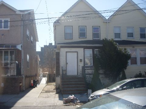 Semi-Attached Home In The Heart Of Far Rockaway. Needs Some Tlc.