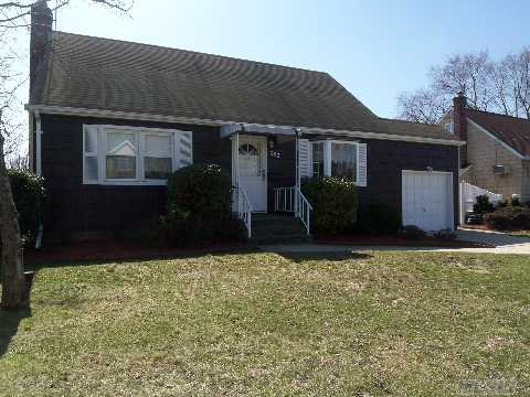 Entry Foyer, Living Room, Dining Area, Eat In Kitchen, Cherry Cabinets With Corian, Hardwood Floors, Walk In Closet In Master, 210Amp Electric, 12 Year Old Heating System, New Stoop, New Concrete Driveway, Patio, Covered Awning, Newer Exterior & Interior Doors, Igs,Mid-Block,'All Nice Size Rms.'