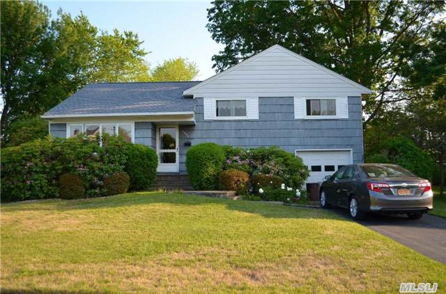 Cherished Home Is Bright & Welcoming! Nestled Mid-Block On Oversized Property In Serene Neighborhood. Wall Of Windows Brings Afternoon Sun Into Spacious Living Rm. Updates Incl. Roof & Some Windows. Levittown School Dist. Seize The Opportunity To Make This Your Home Sweet Home!