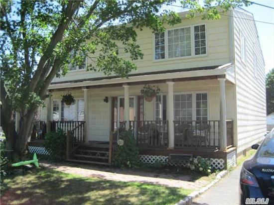 Large Expanded Cape With Open Floor Plan, Great Working Kitchen, Large Center Island, Well Utilized Cabinets, Outside Deck For Entertaining, Two Bedrooms With Bath On First Floor, 3 Good Size Bedrooms And Master Suite With Outside Deck On Second Floor, Wood Floors Through Out,  Cac