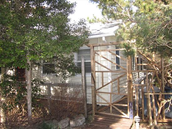 PRICE REDUCTION: This charming Ocean Beach bungalow is located midway between town and the beach.   With vaulted ceilings, skylights, and a working brick fireplace, the living room is the center of this home.  An excellent layout for entertaining, the kitchen is open to the living area, and features a large breakfast bar.  The three oversized bedrooms, 1.5 updated baths, outdoor shower, and spacious private deck, freshly powerwashed and stained, round out this well priced home. Including newly painted interior and exterior.
