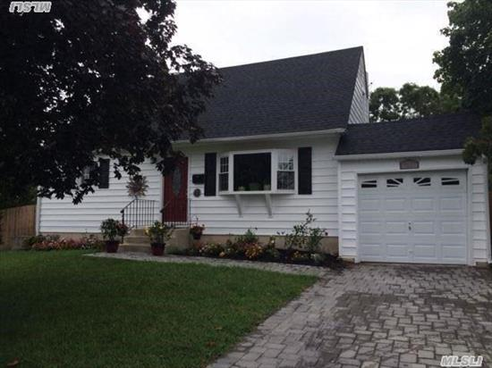 Beautiful Move In Ready Cape~ New Granite/Maple Kitchen With Stainless Steel Appliances. New Granite/Marble Bathroom/Jacuzzi Tub, Hardwood Floors, Large Attached 1 Car Garage With Pavered Driveway, Walkway And Patio In Yard. Large Backyard With Fence.