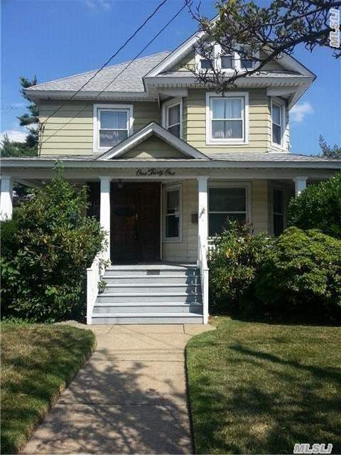 Beautiful Colonial With 4 Bedrooms And 2 Bath With Wood Floors Through Out The Whole House. Front Porch And A Huge Backyard.