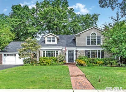 Merrick Woods Brookside Charmer, Large Eik, Large Formal Dr, Living Room W/Fireplace, Large Screened Glass Porch, All Wood Floors, Tile In Kitchen, Andersen Windows Thruout, Closets Galore, New Washer & Hot Water Heater, Fence Outside Is All Cedar Plus Cement Basketball Court.