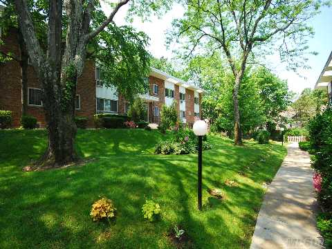 Spacious 1 Br Upper Floor Dream Coop In The Heart Of Oyster Bay, Open And Airy With Vaulted Ceilings And Hardwood Floors.Updated Kitchen: New Fridge, Dw And Above Stove Microwave.  Two New Acs.Corner Apt With Lush Forest Views. Courtyard Setting. Maint. Fee Includes Taxes, Heat And Hot Water. Cats Ok- Unit Currently Is Cat-Free. Close To All!