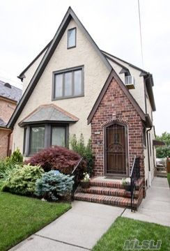Pristine Det Tudor W/ Great Curb Appeal. Landscaping With Mature Plantings. Updated New & Expanded Bright Custom Eat In Kitchen W/ Sky Lights, Stained Glass Windows, & Access To  Deck. Large Inviting  Lr With Stone Fireplace, Entertaining Fdr, Full Fin Basement W/ Lr And New Boiler. Fin Attic, Oversized Mbr W/Dressing Room & 2.5 Renovated Baths. Co As Legal 2 Family.