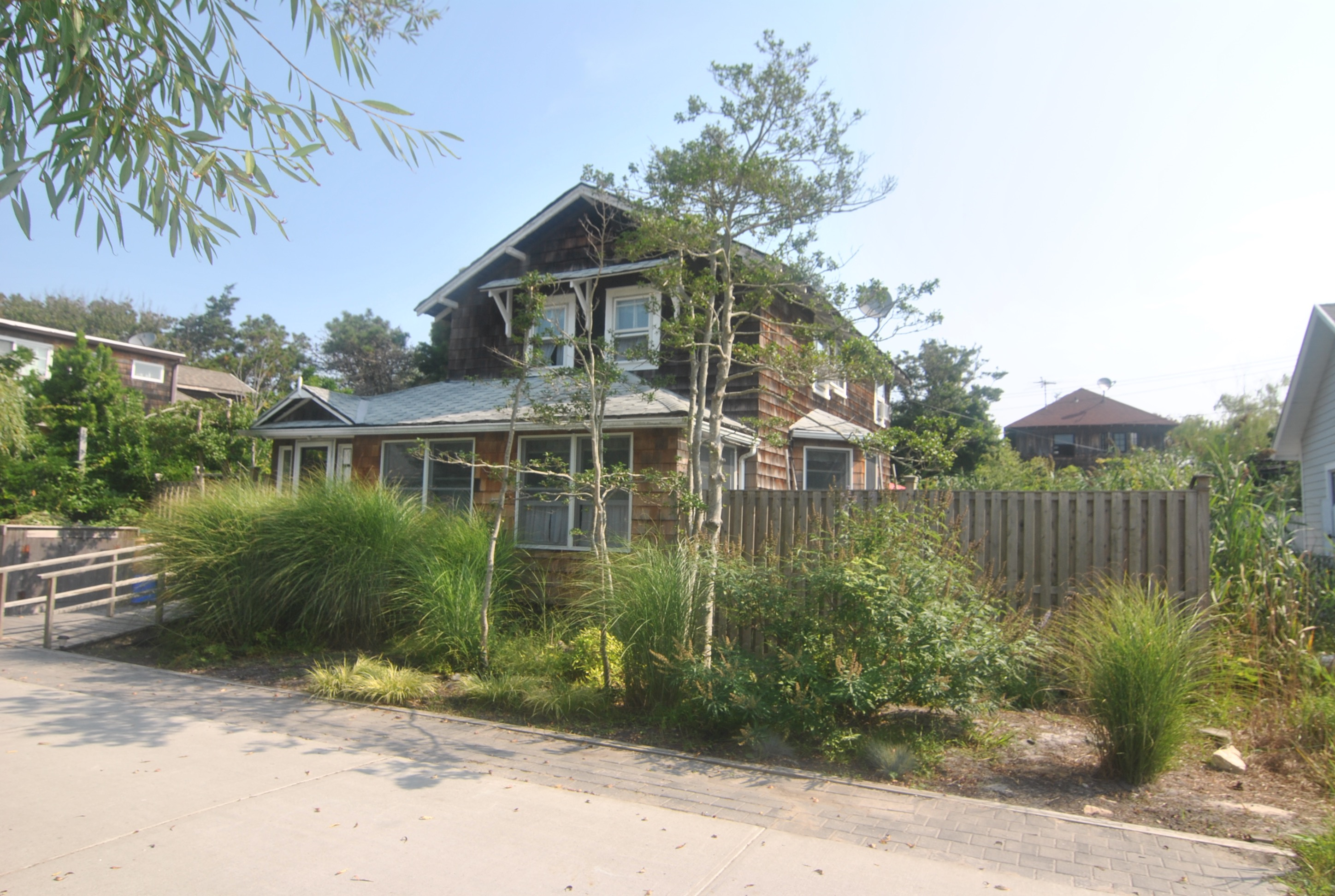 Exclusive Listing<br> This charming Ocean Beach home is filled with traditional charm, but has been modernized for today's buyer.  The sun filled chef's kitchen has been renovated to perfection and has granite countertops, Viking range, a large table to accommodate the whole family and huge sliding glass doors leading to the spacious deck.  The home's 1.5 baths are fully renovated as well.    3 spacious bedrooms.  Great location on the beach block.  Must see to appreciate the fine finishes in this home.
