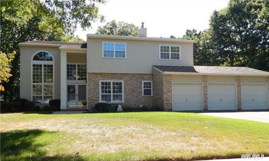 Just Reduced To Allow For Some Updates This Expansive Post Modern Home In Country Woods Comprises 4000 Sq.Feet Offering A Private Guest Quarters, Spacious Eat In Kitchen, Family Room With A Fireplace, Huge Master Suite, Private Office & A Three Car Attached Garage. Make This Your Home For The Holidays!