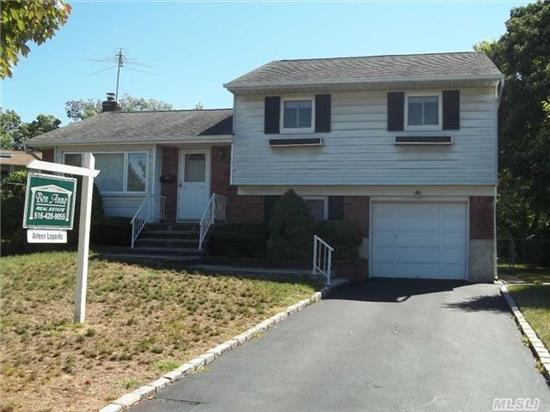 Lovely Split Home..Clean And Great Potential To Make It Your Own! Updated Gas Heating System And Hw Heater. Updated Windows.  Gas Dryer And Stove. Hardwood Floors Throughout. Large Irregular Backyard. 1 Car Garage. Full Basement.