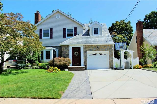 Pristine 3 Bedroom Slate Roof Colonial Living Room/Fireplace Eat-In-Kitchen Corian Counters & Ss Appliances Den Tiled Lower Level Rec Room Hardwood Floors Ba/Fa In-Ground Sprinklers. Award Winning Rockville Centre Schools. Walk To Lirr And Village Restaurants/Shopping.
