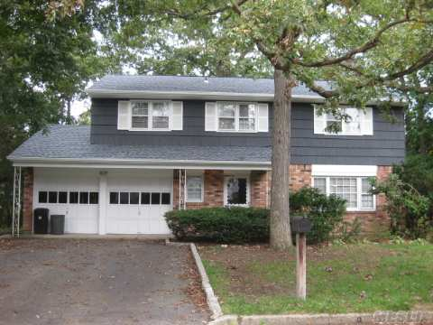 Location! Location! Location! Smithtown At It's Best! The Best Buy In Town Large 4 Bedroom 2.5 Bath, Colonial/Splanch. Master Suite, Den W/Sliders And Fireplace. Basement W/High Ceilings,Formal Lr./Cathedral Ceilings. Prestine Like New Oak Floor,Weil Mclain Burner. New Roof, Soffits,Gutters. Too Much To List! A Great Buy!!!