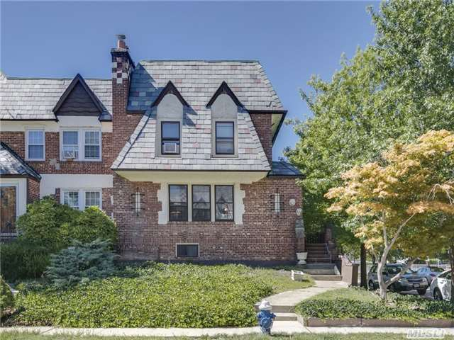 Rare Corner English Tudor Towne House, Beautiful Crown Moldings, Inlaid H/W Flrs, Slate Roof Stone Wbf Lots Of Windows On Side Of House. Eik, 3 Brs. 1 Full Bath, Attic. Finished Basement That Has Entrance To Backyard. Sd #14, Park At End Of Street. Near Shopping And Two Blocks From Lirr. 25Minute Trip To Nyc. Lots Of Room For Parking Plus Garage.