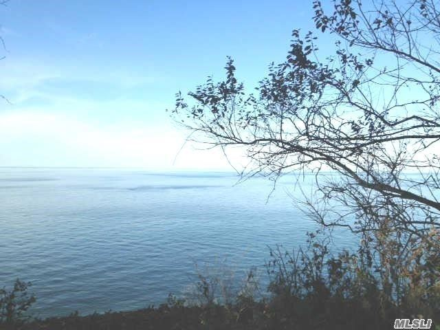 Private Waterfront North Shore Property, Custom Built Home...Hardwood Floors, Anderson Windows, Freshly Painted Thru-Out. Fireplace In Great Room, Make It Your Own, Lower Level Ready To Be Finished With Plumbing, Electric, Roof 10 Yrs. Oil Burner 6, 2 Car Garage.Private Beach Association. Newly Maintained Entrance To Your Beach. Best Views From Lg.Yd And You Own The Bluff.