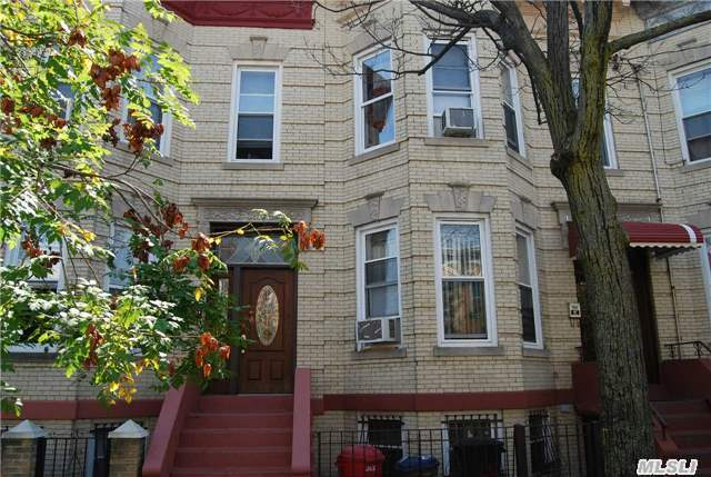 Beautiful 2 Family Brick On A Tree Lined Street Only Blocks Away From Shopping And M Train To Manhattan, 3 Bedrooms Over 2 Bedrooms With Full Basement , Private Yard .