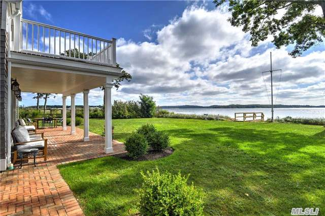 Spectacular Bay Front - Southold. Sunlight Illuminates Throughout This Newly Renovated Home With 110 Feet On Peconic Bay & Endless Views Of Shelter Island. 4 En-Suite Br, + 1.5 Ba, Gr W/ Fpl, Formal Lr & Dr, Gar & Generator. Ease & Elegance Make This Home Perfectly Suited For Entertaining. Close To Award Winning North Fork Vineyards, Farm Stands & Restaurants.