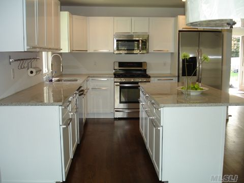 Temporary Price Reduction, Must Be In Contract By 12/24/11. Will Be Removed After.  Exciting & New: Bright & Sunny 4 Br 2 Bath Brand New Complete Renovation.  Hardwood, Open Living, Granite Counters, 5 Top Of The Line Appliances (Not Builder's Grade!), Marble Bathroom, Lovely Yard, Deck, 1 Car Garage With Beach Rights! Low Taxes!!!