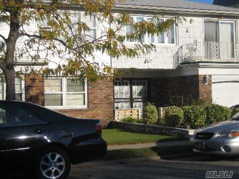 Great Location.  Close To Bay Terrace Shopping Center, Express Bus To Nyc And Lirr. 2 Family Home Featuring Large Beautiful Entry Foyer And One Apt With 3 Bedrooms And 2 Baths. Other Apt With 2 Bedrooms And 1 Bath And Sep Entrance.