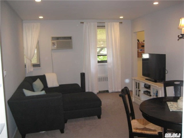 Move Right In! Well Maintained Converted 3 Bedroom Upper Bright Unit. Renovated Kitchen,  Bath,  New High Hats,  Washer,  Dryer,  Dishwasher,  Lots Of Closets. Walk Up Attic. Close To Transportation-Qm20,  Q16,  Qm2. Dist. 25- P. S. 209,  Jhs 194.  Mint! Must See!! Base Maintenance Is $927.91. $7.50 (Dishwasher)+$6.50(Washer)+$6.25(Dryer)+Ac Fees.